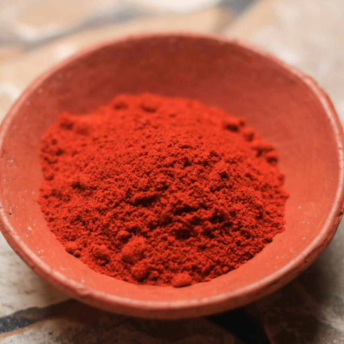 A bowl with bottle masala spice mix.