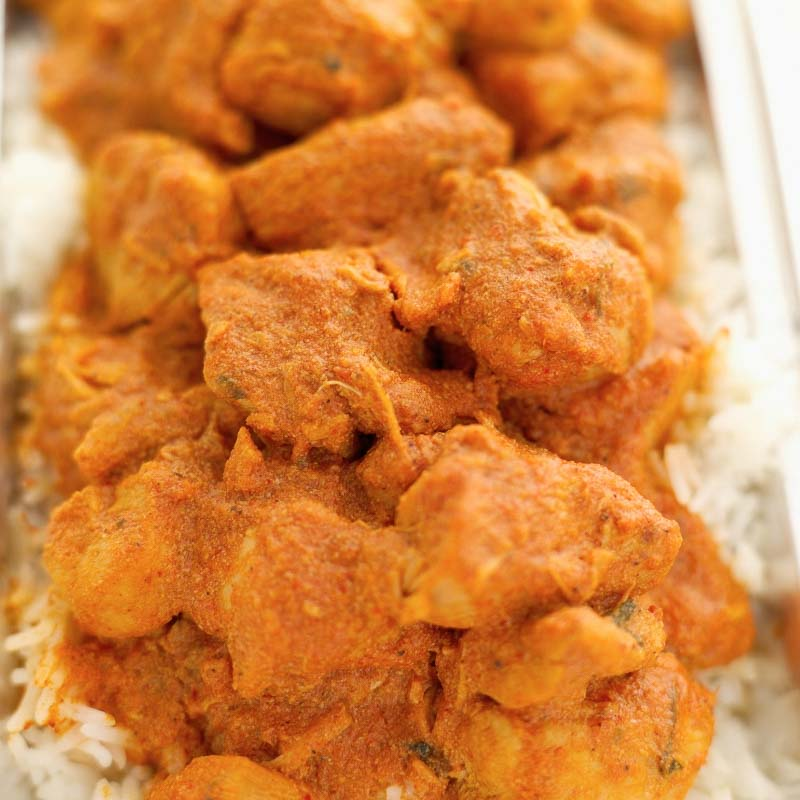 Indian curry plated over steamed rice