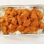 Indian Curry plated over steamed rice.
