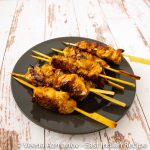 A display of kebabs made with boneless chicken