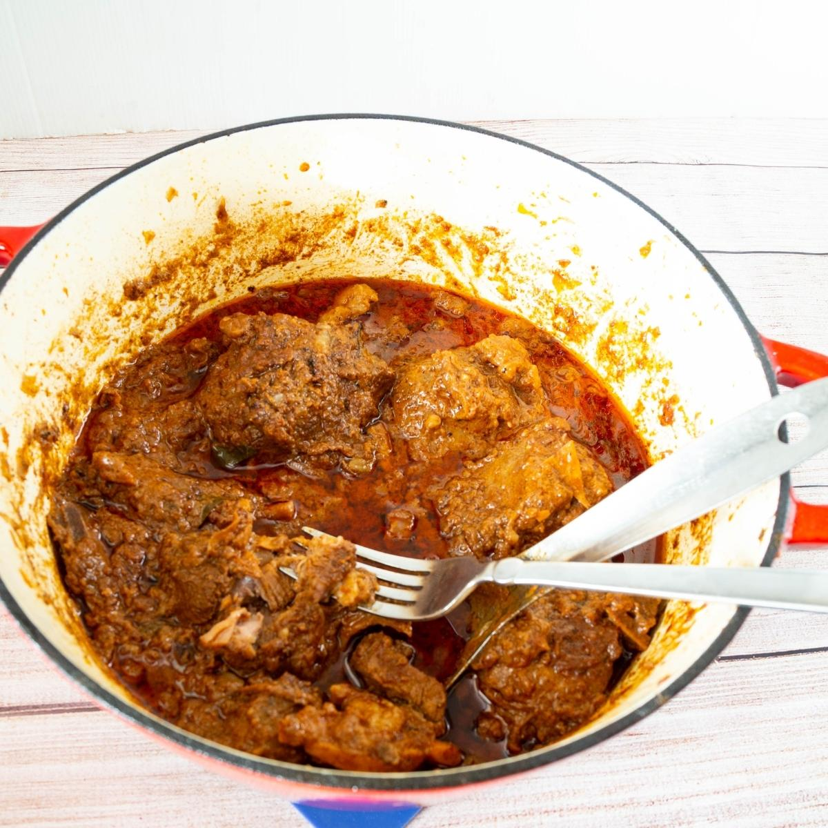 A Dutch oven with mutton curry.