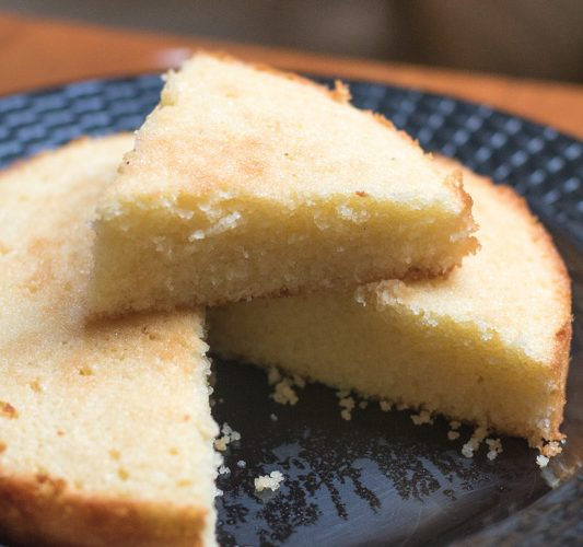 Thali Sweet is a moist coconut cake popularly made by East Indians in a traditional round flat aluminum pan
