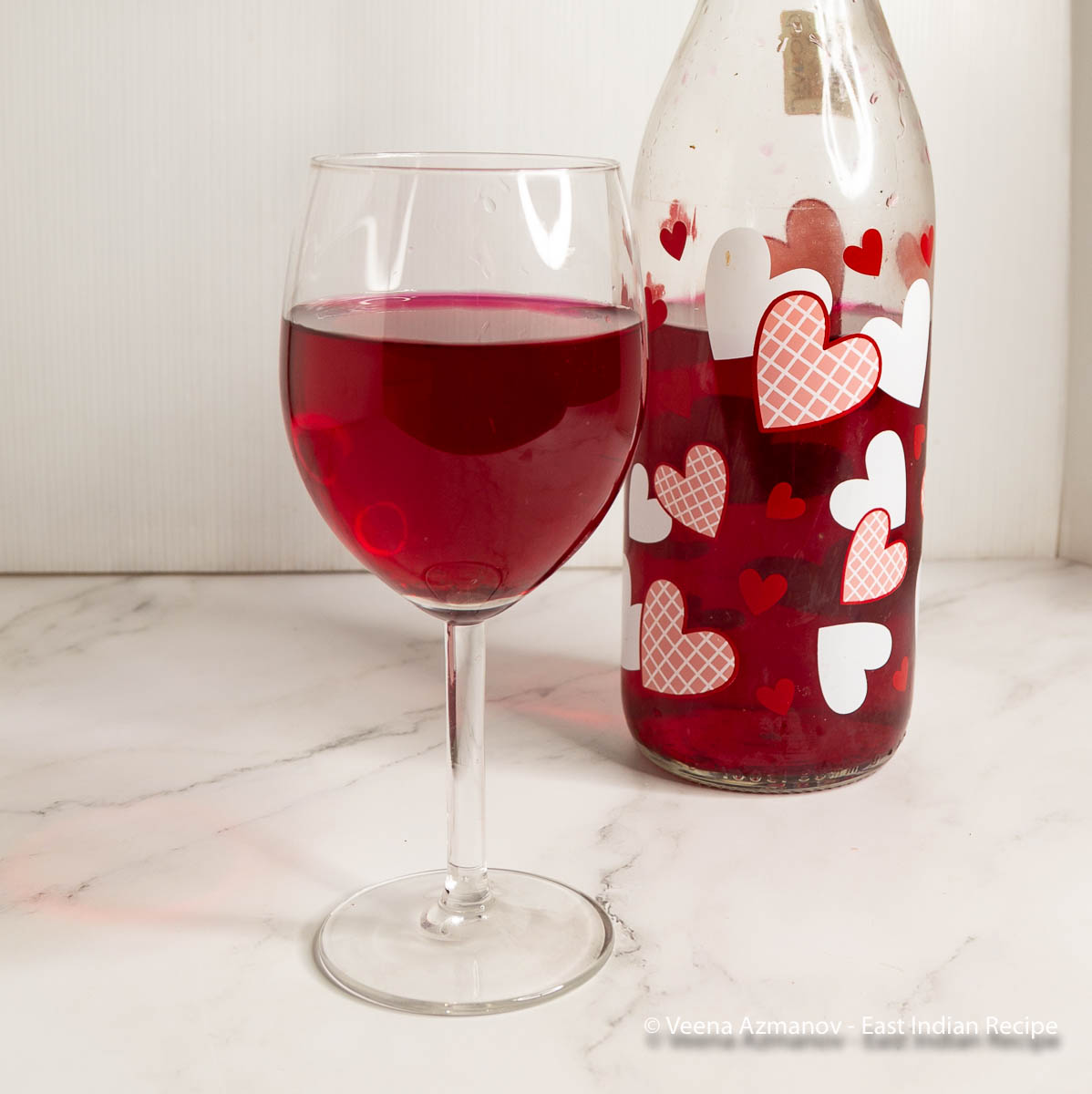 A wine glass with beetroot wine.