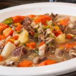 A white bowl with mutton stew.