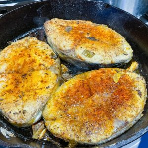 A cast iron skillet with fish.
