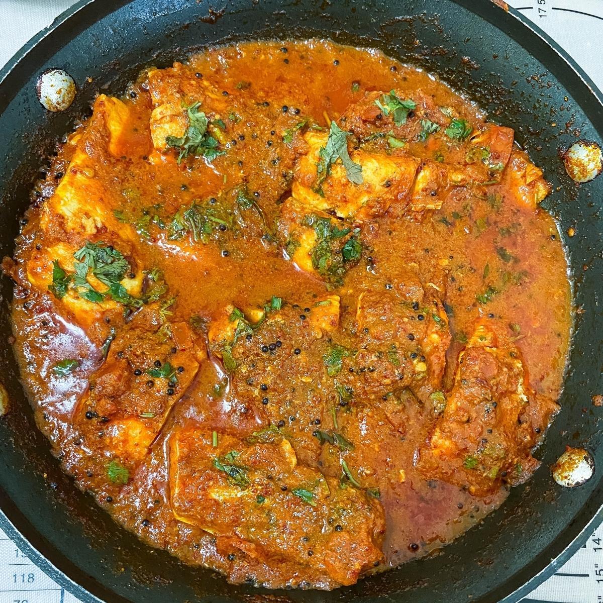 Fish curry in the skillet.