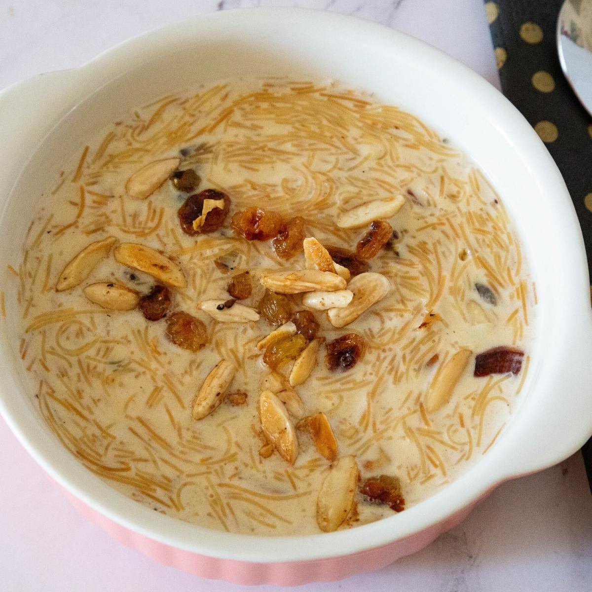 Vermicelli pudding in a bowl with nuts.